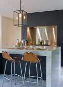 Marble kitchen island and bar stools with leather covers