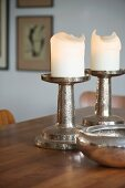 Chunky, hammered silver candlesticks and matching bowl