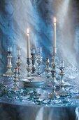 Crockery and silver candlesticks