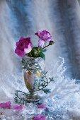 Violet roses in antique vase