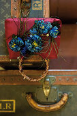 Handbag adorned with decorative plumes