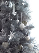 Christmas tree with white and silver baubles