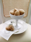 Macaroons in white china dish with Christmas bauble