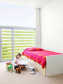 Girl's bedroom with louver blinds