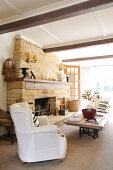 Bright living room with rough stone fireplace