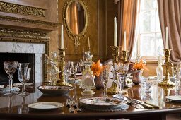 Festive table set with crockery and crystal wine glasses in grand room