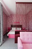 Contemporary bedroom in shades of pink and grey - thread curtain as transparent partition screening double bed