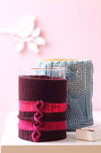 Candle holders with knitted covers