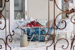 Old metal furniture on farmhouse veranda