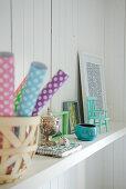 Knick-knacks on shelf on white wooden wall