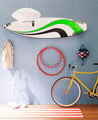 Sporting equipment hanging on perforated wall panel in teenager's bedroom