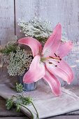 Arrangement of pink lilies and wild carrot