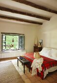 Double bed in country-style bedroom