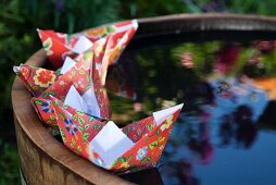 Paper boats on miniature pond