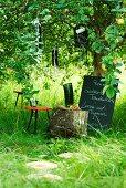 Garden party menu board below tree