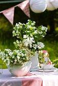 Flower arrangements on garden table