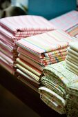 Striped and floral fabrics stacked on table