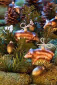 Christmas tree decorations shaped like wild boar and acorns