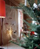 Linen cloth hand-painted with tree as wall hanging in festive room