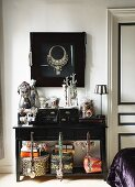 Jewellery and storage boxes on black console table