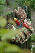 Gardening tools hanging at fence