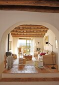 Mediterranean interior with wooden ceiling and adjoining terrace in renovated, Spanish country house