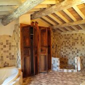 Large Mediterranean bathroom with storage room in fitted cupboards and open shower area below rustic roof structure