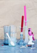 Drinking glass, vase, carafe and candlesticks made of water bottles and wine bottles