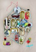 Hand-crafted display case made from old tin cans