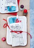 Cutlery and napkin in jewellery repair envelope