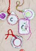Decorated foil pot lids used as picture frames and pendants