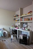 Corner of teenager's bedroom - classic metal chair at desk and minimalist wall-mounted shelving