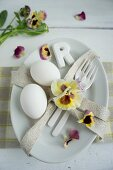 Place setting decorated with pansies & eggs