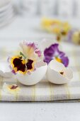 Easter table centrepiece with egg shells & pansies