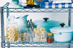Storage containers and blue pots on a shelf