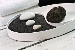 Yin and Yang dish with black pumice and white pebbles