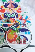 Russian dolls in circular shelving units in front of colourful wall sticker