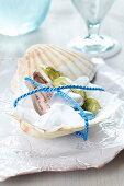Small present: scallop shell dish of sweets tied with cord