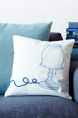 Scatter cushion with iron-on picture of lamp and appliqué cord as cable