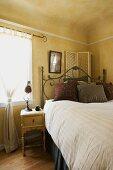 Vignette of naturally lit bedroom.