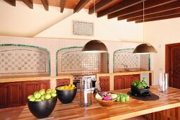 Bowls on fruits and vegetables on wooden table in kitchen