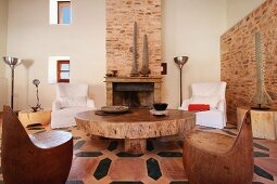 Wooden chairs and coffee table in Spanish style home