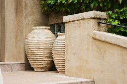 Vignette of two large clay pots.