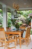 Outdoor dining area with wooden table and chairs