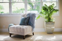 Contemporary chair with throw pillow and blanket