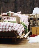 designer hocker aus nussbaumholz auf filzteppich im hintergrund paneel in steinwand optik und. Black Bedroom Furniture Sets. Home Design Ideas