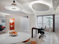 Modern interior with dining area and desk