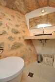 Bathroom with stone wall