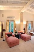 Pink chaise lounges in living room