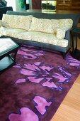 Detail sofa on purple area rug